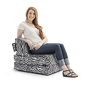 girl in tri fold chair